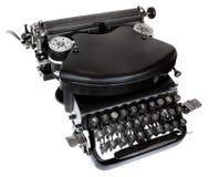 Typewriter. Massive Old black typewriter isolated on white background Stock Photo