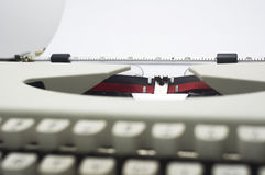Typewriter. A close up of typewriter, focus on paper where message will be typed stock photos
