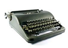 Typewriter. An old portable metal manual typewriter on a white background royalty free stock photo