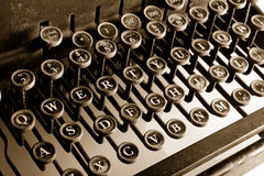 Typewriter. Old-fashioned typewriter with sepia cast royalty free stock photography