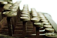 Typewriter. Side view of old typewriter, metal looking tint Royalty Free Stock Photography