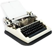 Typewriter. With the inserted leaf of a paper in the carriage royalty free stock images