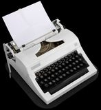 Typewriter. With the inserted leaf of a paper in the carriage stock photography