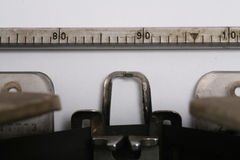 Typewriter. Close-up of vintage typewriter with blank paper Royalty Free Stock Photography