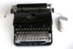 Typewriter. And computer mouse Stock Photo