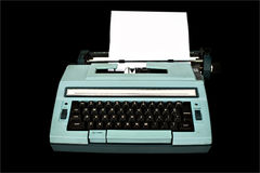 Typewriter. Old typewriter isolated with clipping path over black background Stock Image