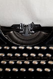 Typewriter with aged textured paper Royalty Free Stock Images