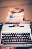 Typewriter antique vintage style with old documents or old letter and books for writer on wooden desk zoom in front view. Of typewriter writer or editor in stock photography