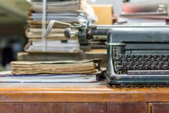 Typewriter antique vintage style and old documents. Typewriter antique vintage style with old documents or old letter for writer on wooden desk zoom in front stock photography
