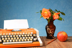 Typewriter Apples And Flowers In A Vase Royalty Free Stock Images
