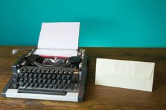 Typewriter and blank envelope Stock Image