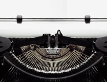 Typewriter with Blank Paper Stock Images