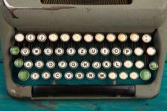 Typewriter on the blue wooden desk. Vintage typewriter on the blue wooden desk Stock Photo