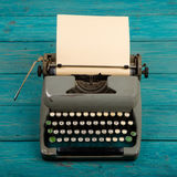 typewriter on the blue wooden desk Stock Photography
