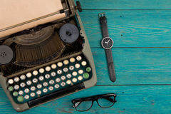 typewriter on the blue wooden desk Royalty Free Stock Photography