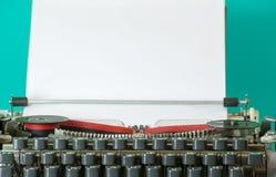 Typewriter closeup. Detail of an old retro typewriter and blank paper Royalty Free Stock Image