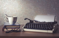 Typewriter with coffee cup,book and eyeglasses,vintage filtered Stock Images