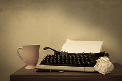 Typewriter with coffee cup and pen,sepia color filtered. Royalty Free Stock Photos