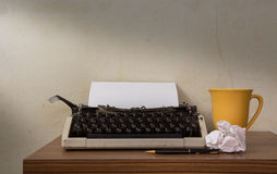 Typewriter with coffee cup and pen. Royalty Free Stock Photo
