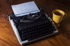 Typewriter with coffee cup Royalty Free Stock Photos