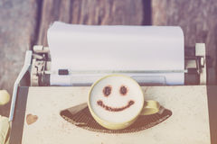 Typewriter with coffee cup, sepia tone. Stock Photography