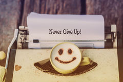 Typewriter with coffee cup, sepia tone Stock Photo