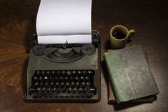 Typewriter coffee and notebook on wooden table Stock Photography