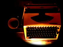 Typewriter and coffee. Yellow vintage typewriter next to a cup of coffee Royalty Free Stock Image