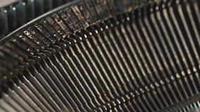 Typewriter detail, mechanical metal parts working, ink typing. Typewriter detail, mechanical metal parts working, ink typing stock video footage