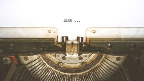 Typewriter and empty white paper with a word Dear, vintage style Stock Image