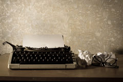 Typewriter with eyeglasses and papers Stock Image