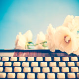 Typewriter and Flowers Stock Photos