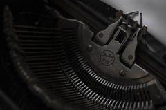 Mechanism of typewriter typewriter, black background royalty free stock photography