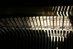 Typewriter hammers. Old technology: typewriter hammers in dramatic lighting Royalty Free Stock Photography