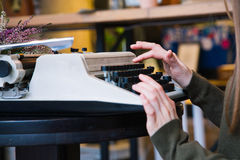 Typewriter and hands Stock Images