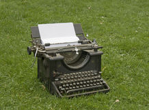 Typewriter on the lawn royalty free stock photo