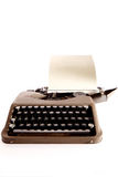Typewriter letter and bow ribbon cover is open. Conic typewriter from bestselling novel royalty free stock photo