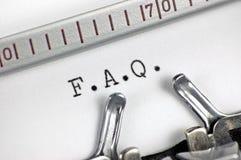 Typewriter macro closeup, typing FAQ Royalty Free Stock Photos