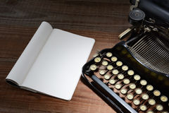 Typewriter and Note Pad Stock Photography