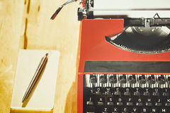 Typewriter and Notebook - Top View Stock Photo
