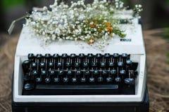 Typewriter. Old fashioned, vintage typewriter with flowers stock photos