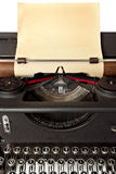 Typewriter with Old Paper. Vintage typewriter with sheet of old blank yellowing paper stock image