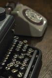 Typewriter and old phone Royalty Free Stock Photos