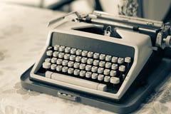 Typewriter. An old typewriter on a working desk in vintage sepia royalty free stock images