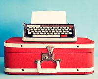 Typewriter over suitcase stock photos