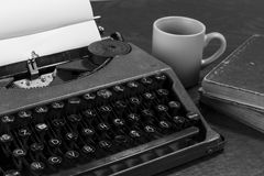 Typewriter paper and coffee Royalty Free Stock Photos