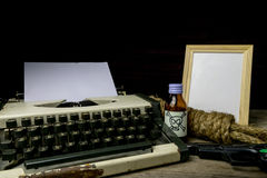 Typewriter with paper page and poison and gun. Concept writer Ro. Mance Suspense, closeup Royalty Free Stock Photography