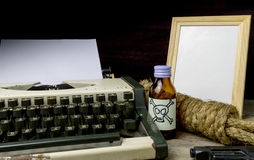 Typewriter with paper page and poison and gun. Concept writer Romance Suspense Stock Image