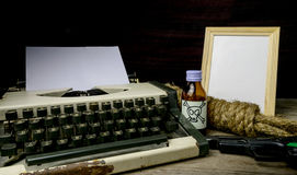Typewriter with paper page and poison and gun. Concept writer Romance Suspense Royalty Free Stock Images