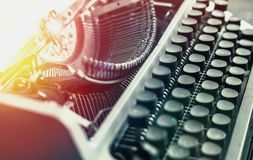 Typewriter With Paper Sheet, Close-up Black And White With Sunshine. Writer Book Concept royalty free stock image